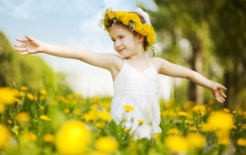 Little Girl With Flower In Field