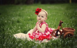Little Princess Sitting On Grass