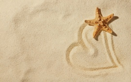 Love Heart In The Sand On A Beach