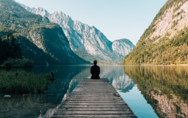 Meditating Man On Mountain Lake