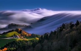 Mist Sweeping A Hill