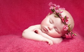 Newborn Little Girl And Flowers