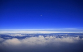 Over the clouds and the moon