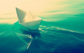 Paper Ship In Green Water