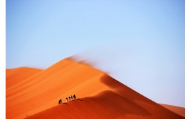 People Walking On Sand Dune