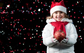 Pretty Girl Holding A Christmas Ball
