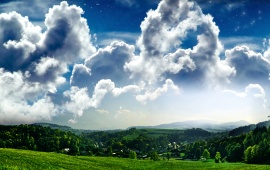 Puffy Clouds Above the Green Field
