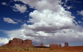 Puffy Clouds Over Monument Valley