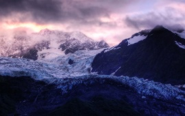 Purple Clouds Above Snowy Mountains