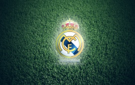 Real Madre FC Club Logo On Grass