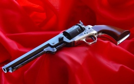 Revolver On Red Cloth