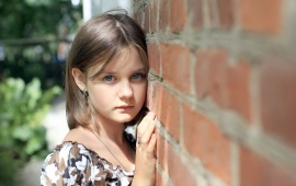 Sad Girl Near Brick Wall