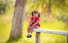 Sad Little Girl Sitting On Bench