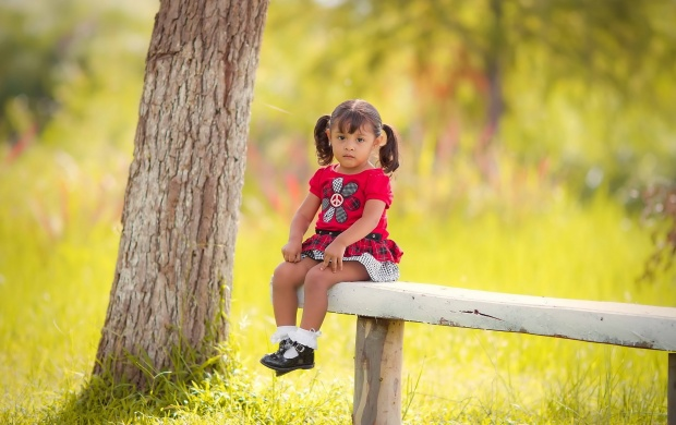 Sad Little Girl Sitting On Bench (click to view)