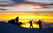 Skiers At Sunset