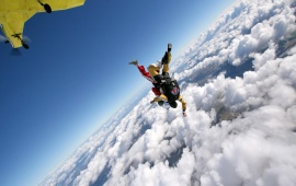 Skydiver In A Cloudy Sky