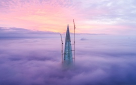 Skyscraper Above The Clouds