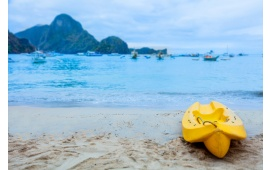 Small Yellow Boat On A Beach