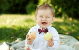 Smiley Baby Holding Apple