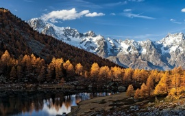 Snowed And Autumn Mountains