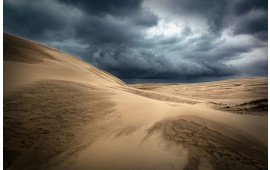 Stormy Clouds Above The Sand Dunes