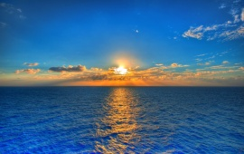 Sunset On Blue Sea Water