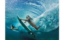Surfing Girls Under A Wave