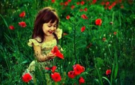 Sweet Little Girl In Garden