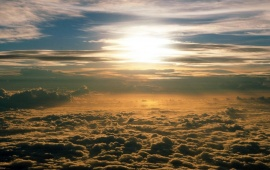 View of the Sun Above the Clouds