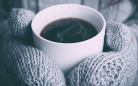 Warm Cup of Coffee In The Hands
