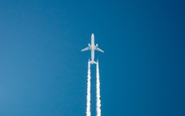 White Aircraft In The Blue Sky