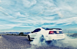 White Ford Mustang On Road