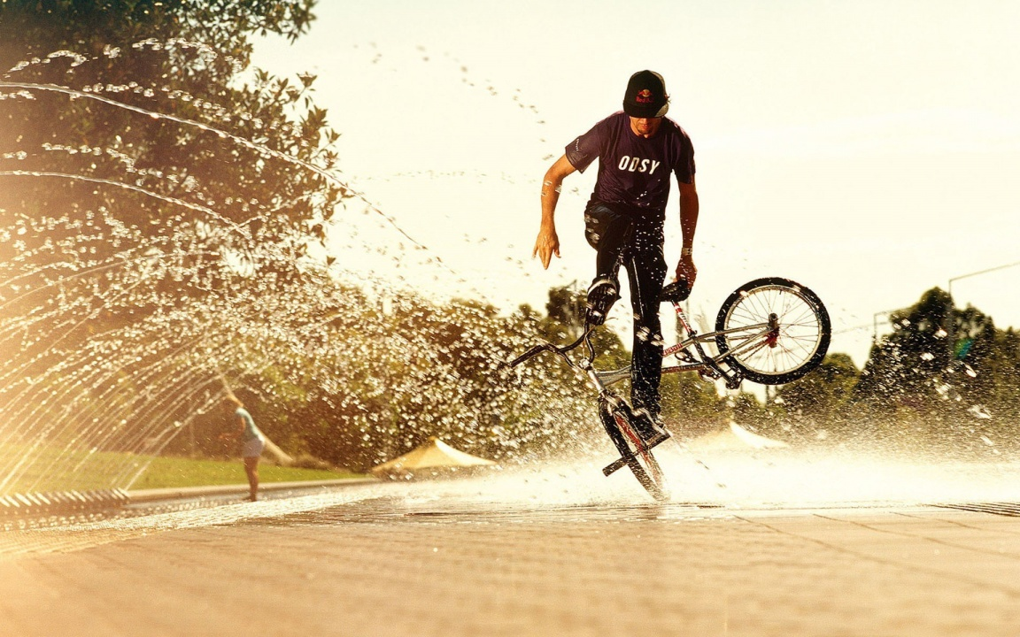 Bikes Man And Water Spray