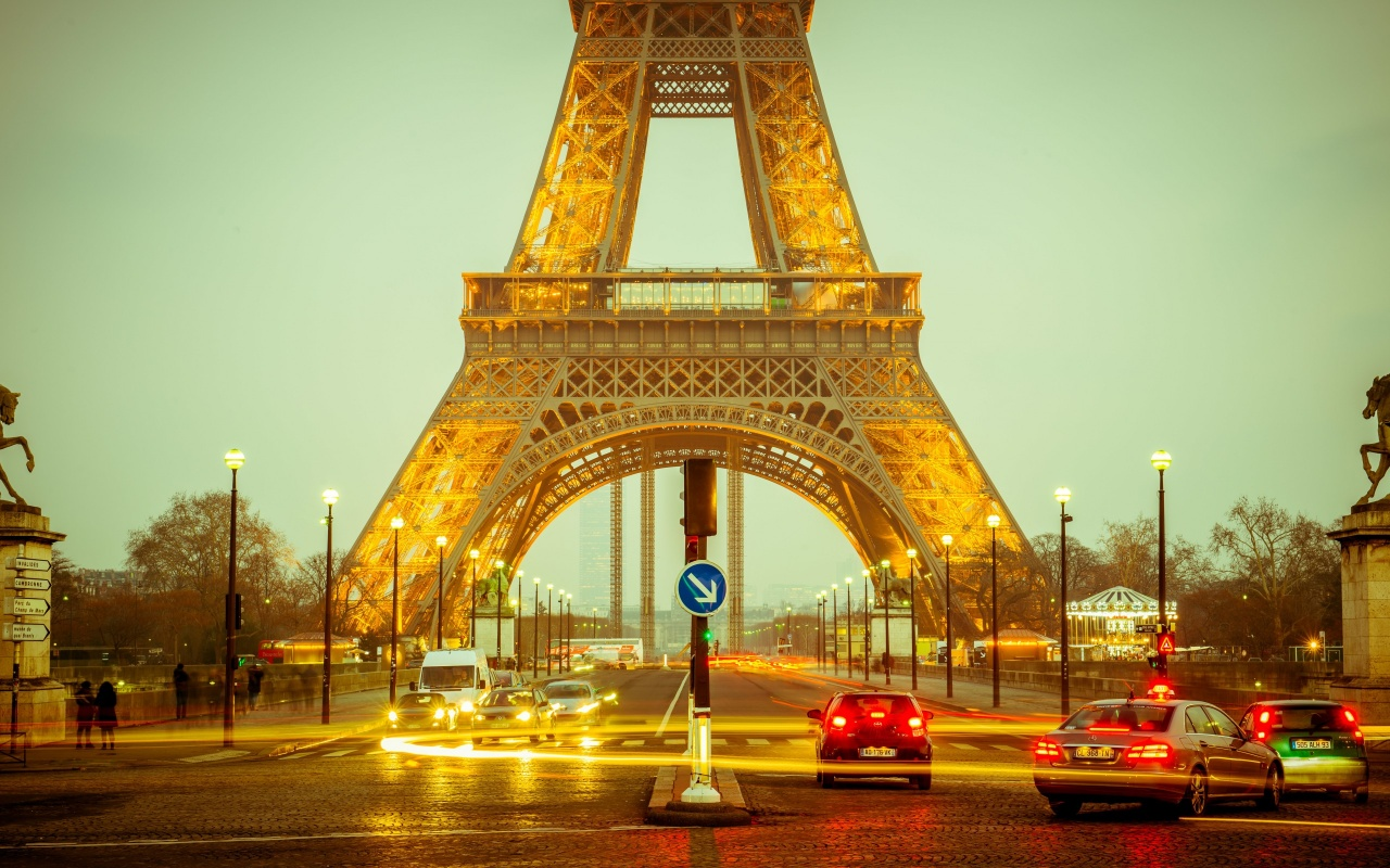 Eiffel Tower Paris And Evening Lighting
