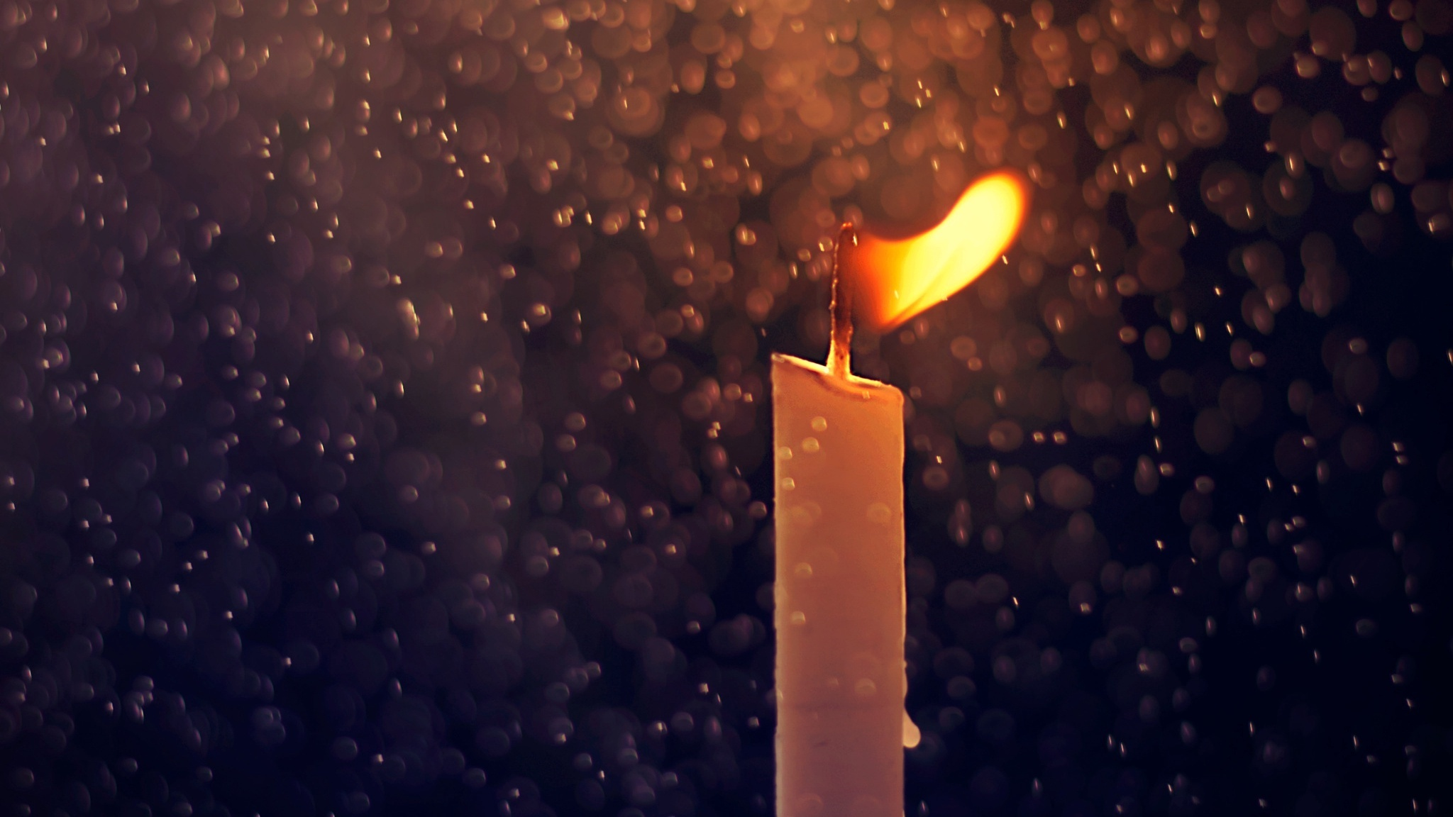 Fire Candle And Rain Drops