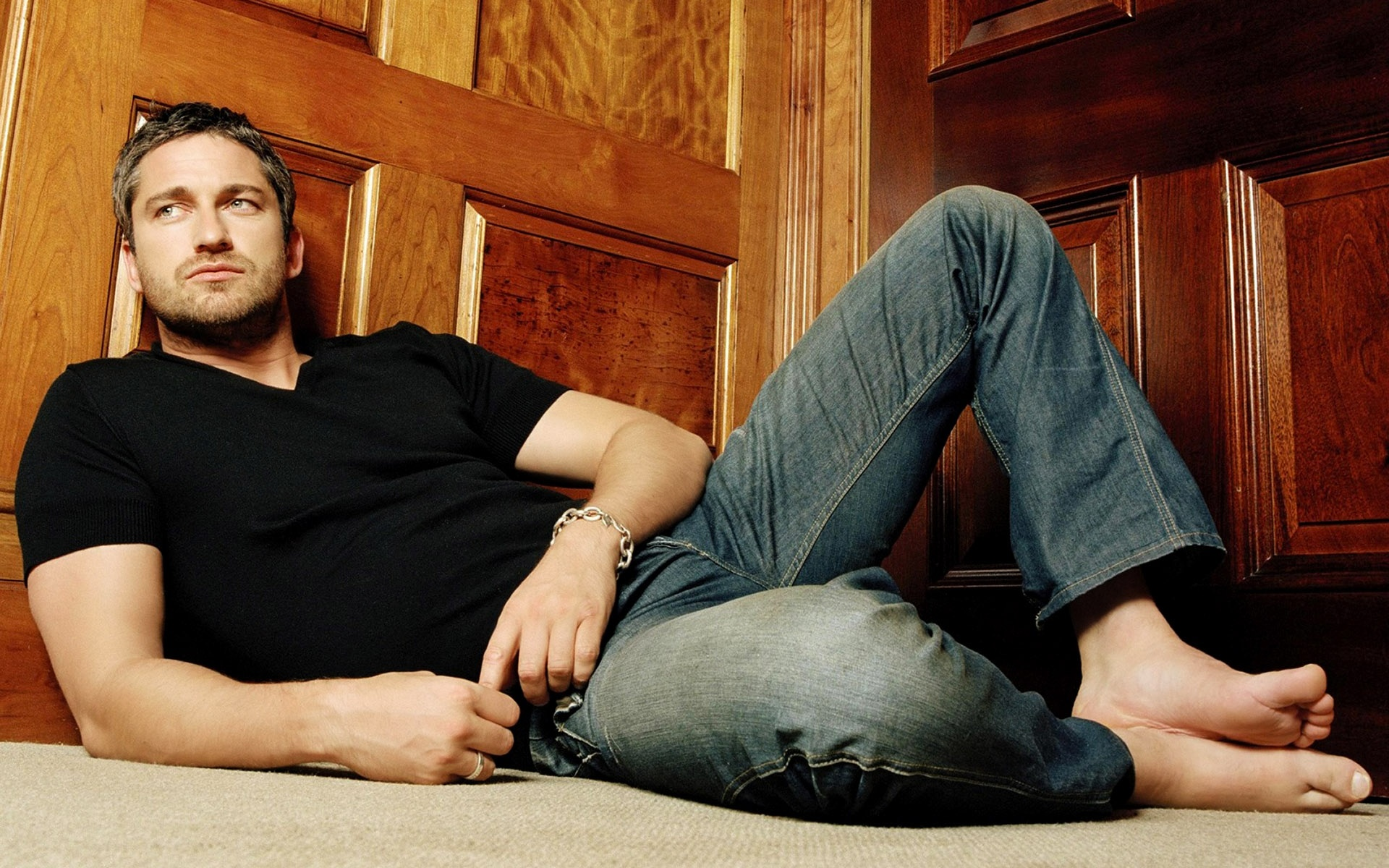 Gerard Butler lying on the floor