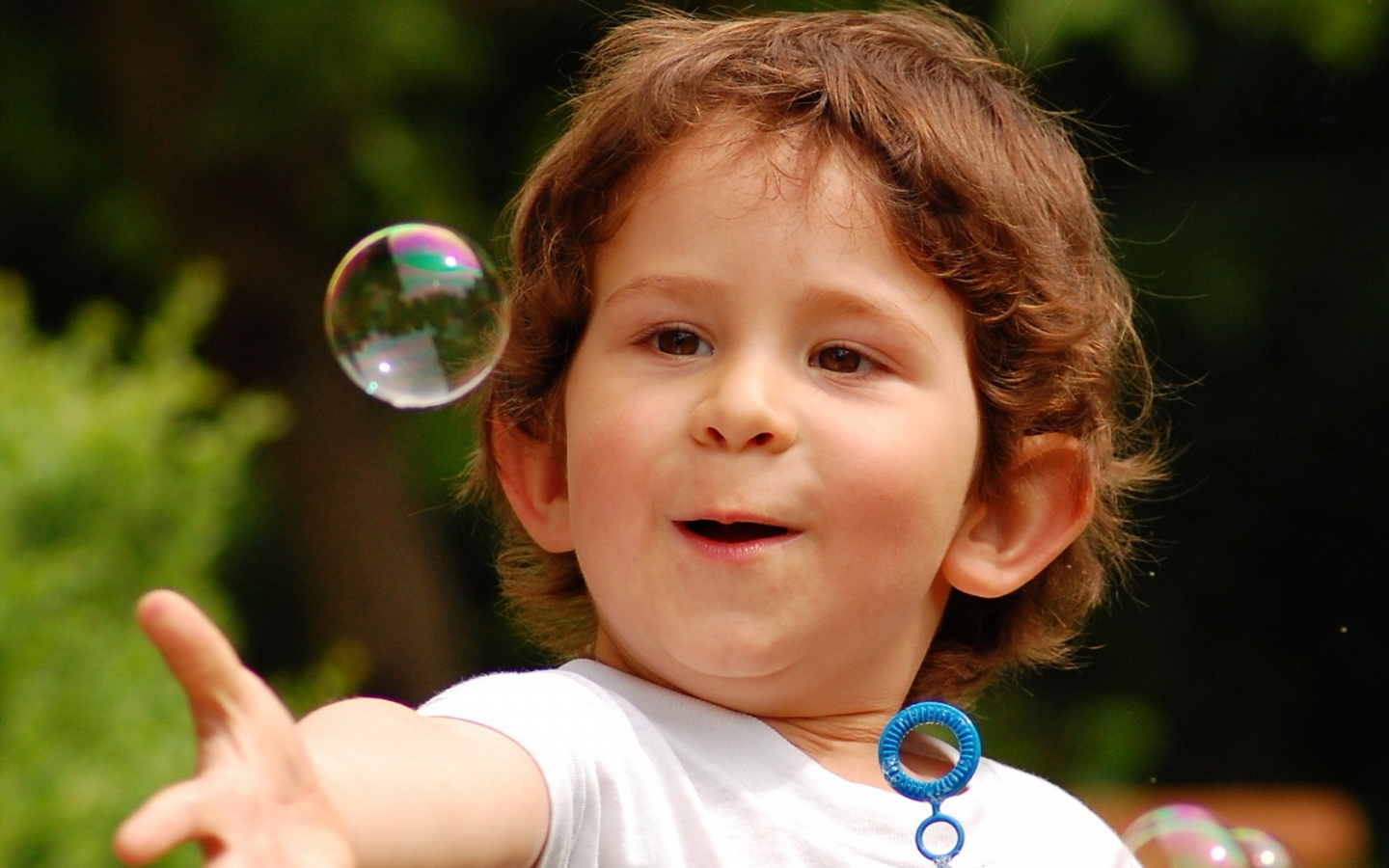 Happy Child Touching Bubble