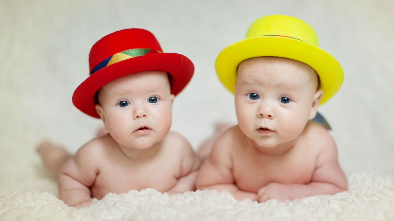 Red And Yellow Hat In Two Babies