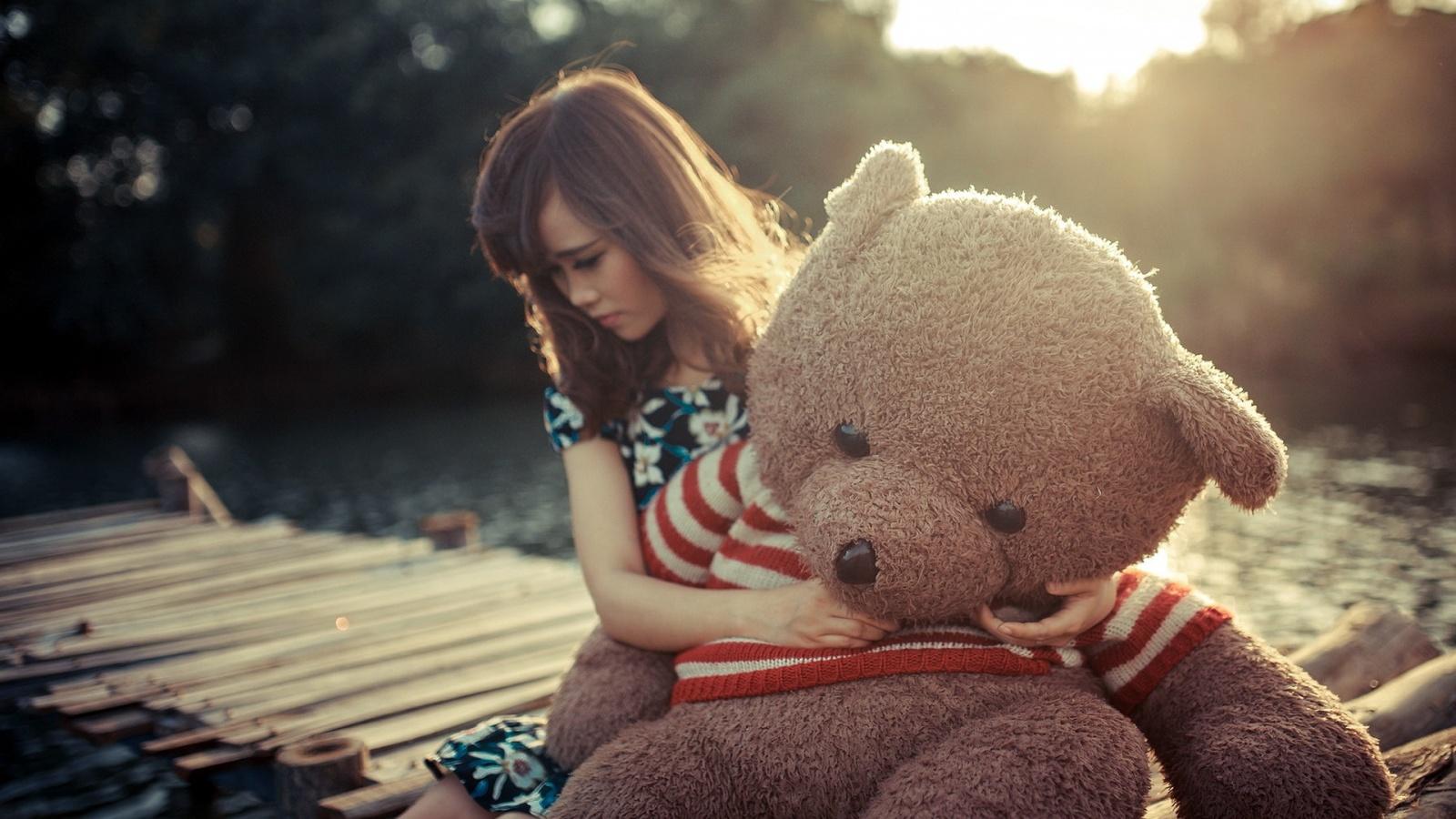 sad girl with teddy bear wallpaper