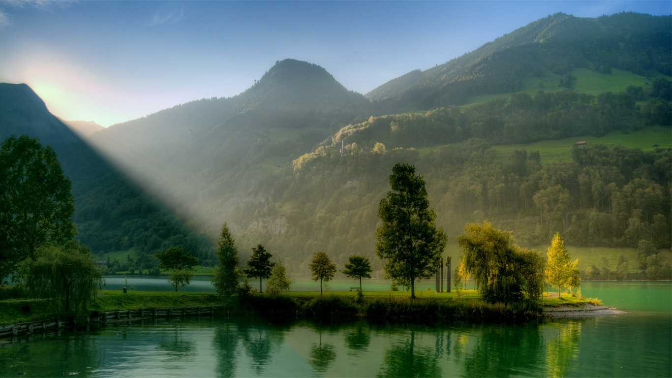Sunlight Over Mountain Lake