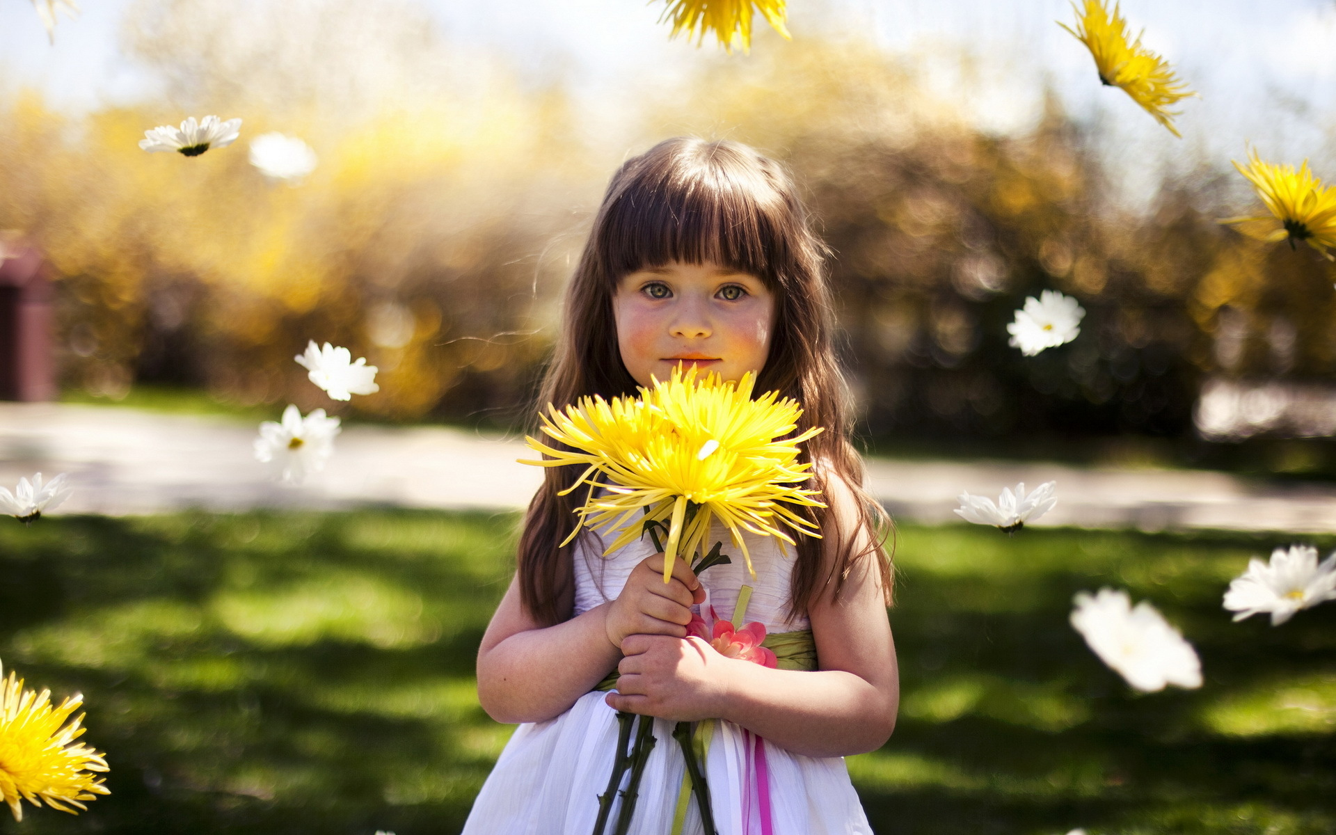 cute little girl holding yellow flower wallpapers