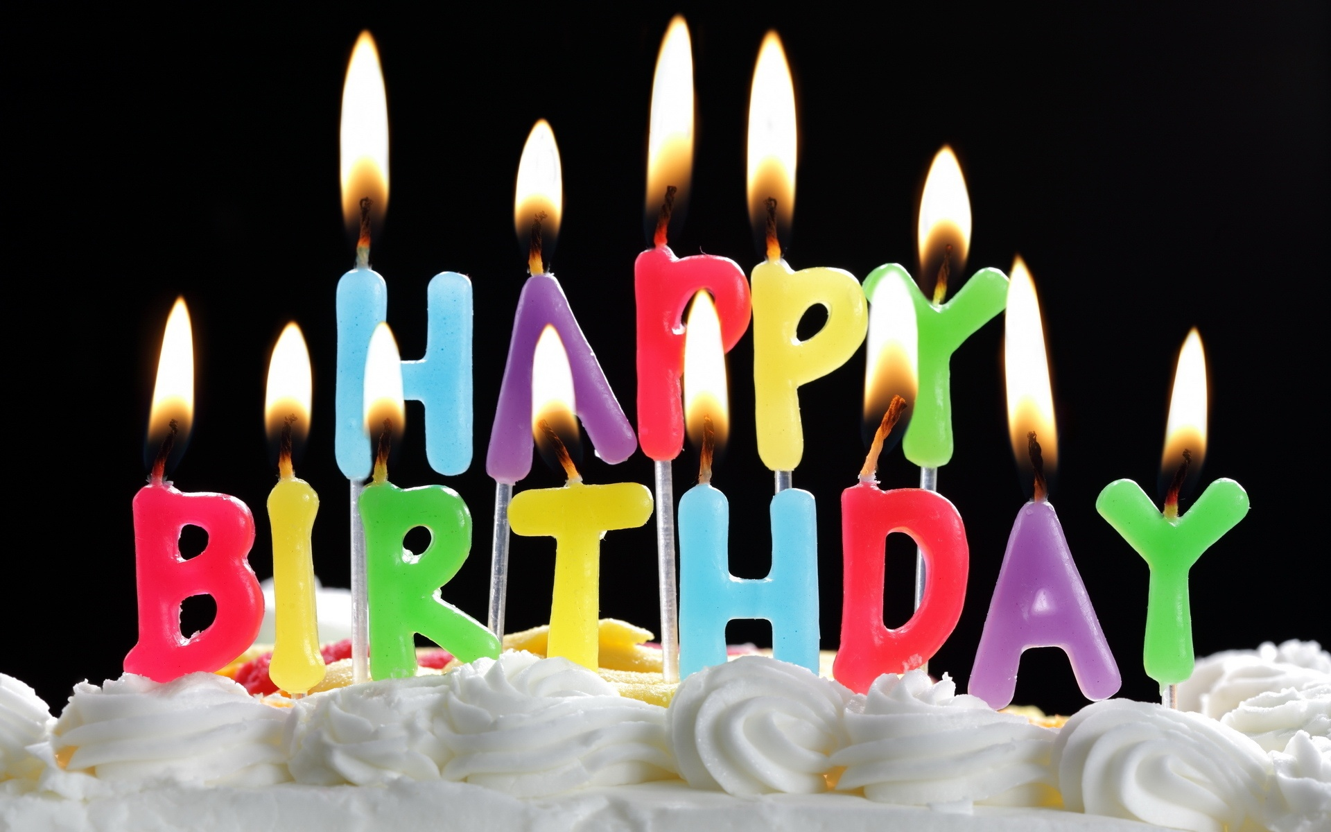 http://www.bhmpics.com/walls/happy_birthday_cake_with_candles-wide.jpg